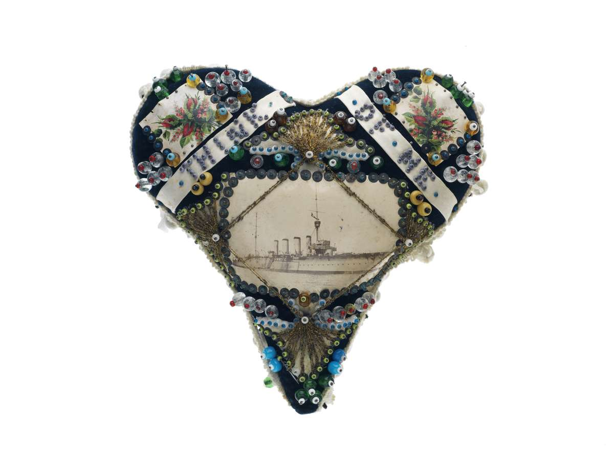 "The image of the pierced heart was a popular motif for sailors, universal in its meaning of love and separation. ANMM collection <a href=""http://collections.anmm.gov.au/en/objects/details/42118/heart-shaped-pin-cushion-think-of-me--hmas-sydney-i?ctx=628a96b4-3b7d-4ed8-931b-24bb2c9b77e9&idx=0"">00006919</a>."