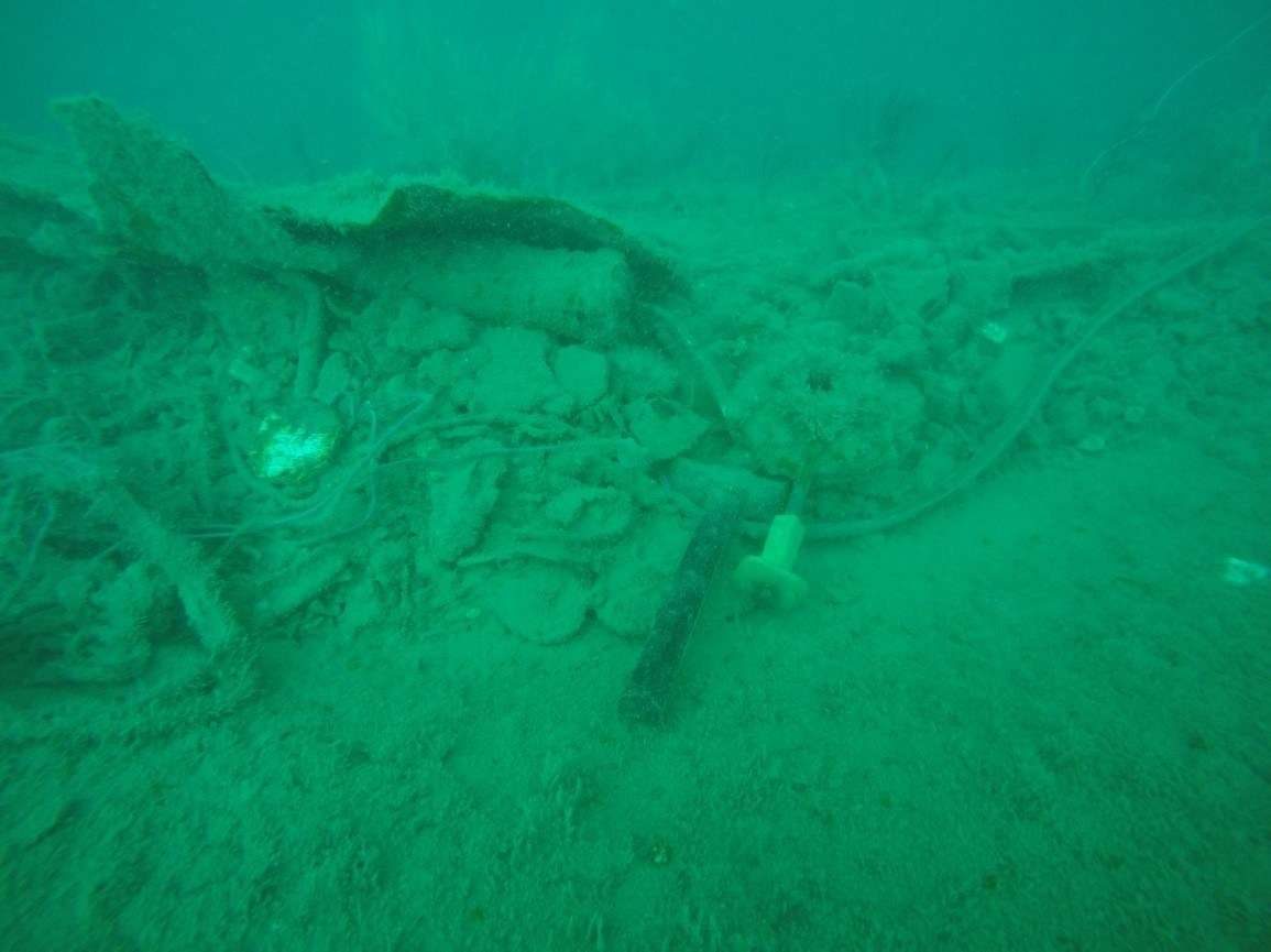 A hammer and other evidence of industrial level salvage operations undertaken illegally on HMAS <em>Perth</em>. Image: Kieran Hosty, ANMM/Pusat Penelitian Arkeologi Nasional.