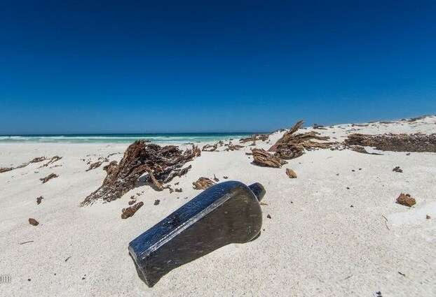 An old bottle found recently on a West Australian beach contained a message from 1886. Image: ©<a href='www.kymillman.com'>Kym Ilman</a>.