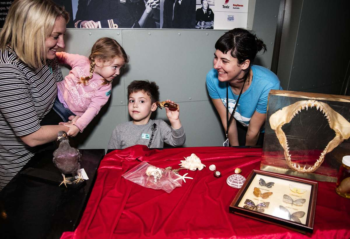 Kids on Deck staff presenting the Cabinet of curiosities. Image: ANMM.