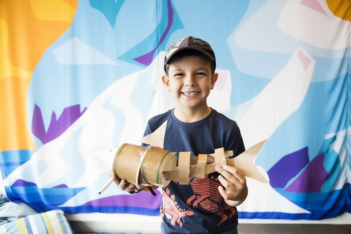 A proud paper sculptor from Kids on Deck, 2017. Image: ANMM.