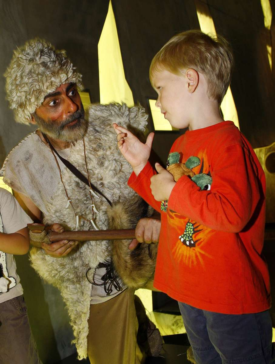 Character guide chameleon John Lamzies as Otzi the Iceman, 2007. Image: ANMM.