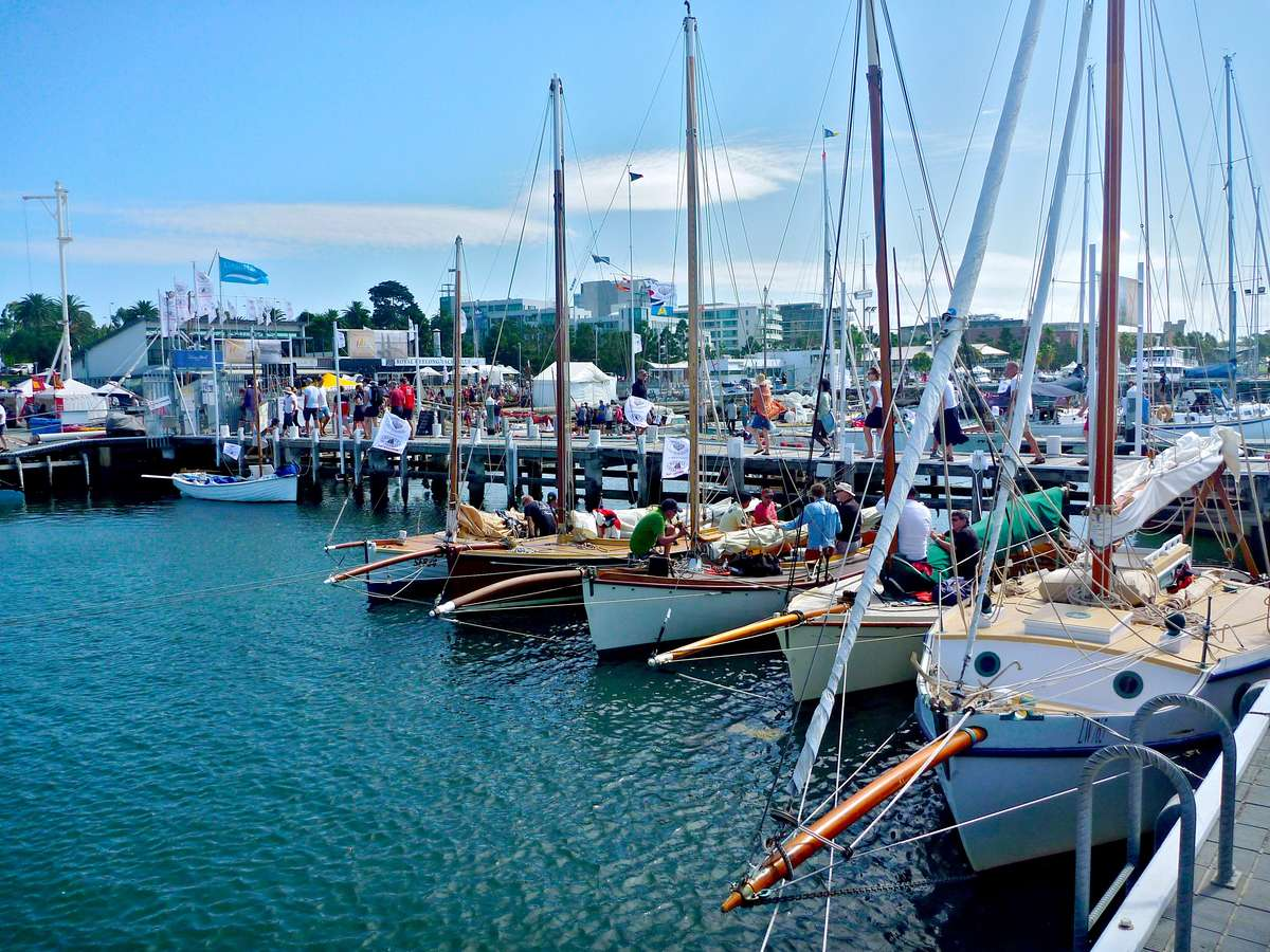 A view of the 2018 Wooden Boat Festival of Geelong, onshore with some of the couta boats in the foreground. Image: David Payne/ANMM.