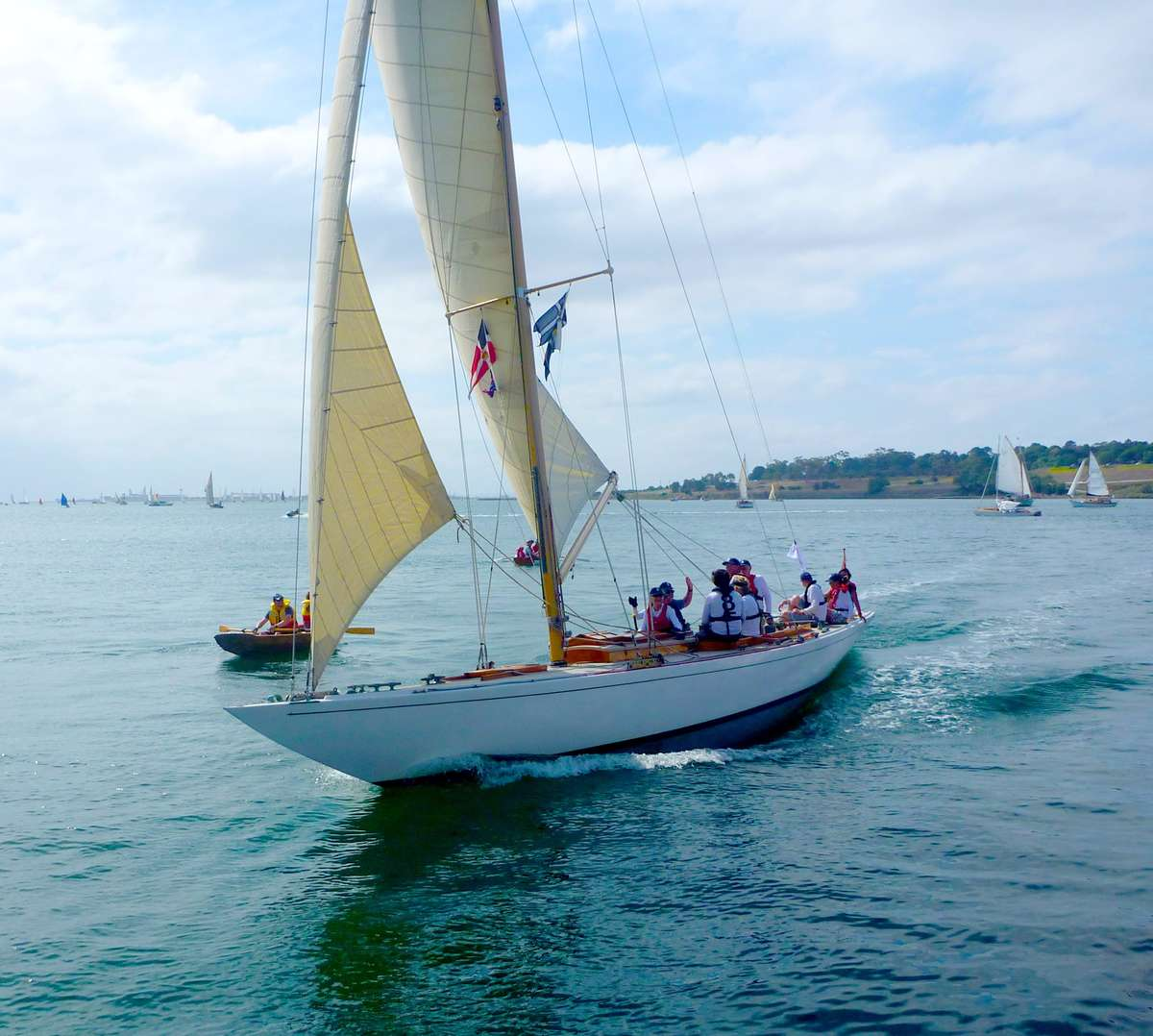 The Ernest Digby designed and built 8 metre class <em>Frances</em> sailing past the breakwater. Image: David Payne/ANMM.