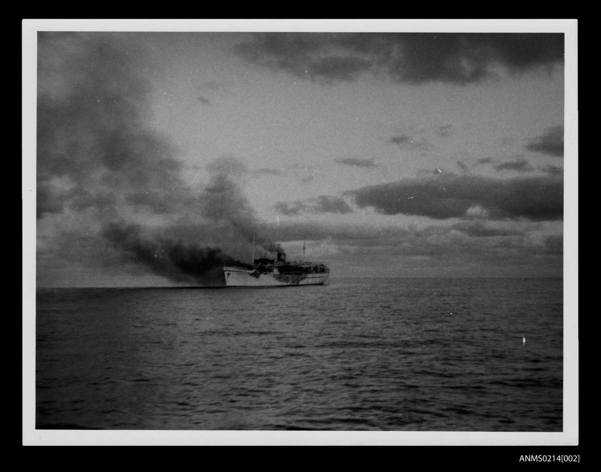 Port bow view of the Norwegian liner Skaubryn on fire in the Indian Ocean, 1958. ANMM Collection Gift from Barbara Alysen ANMS0214[002]. Reproduced courtesy International Organisation for Migration.