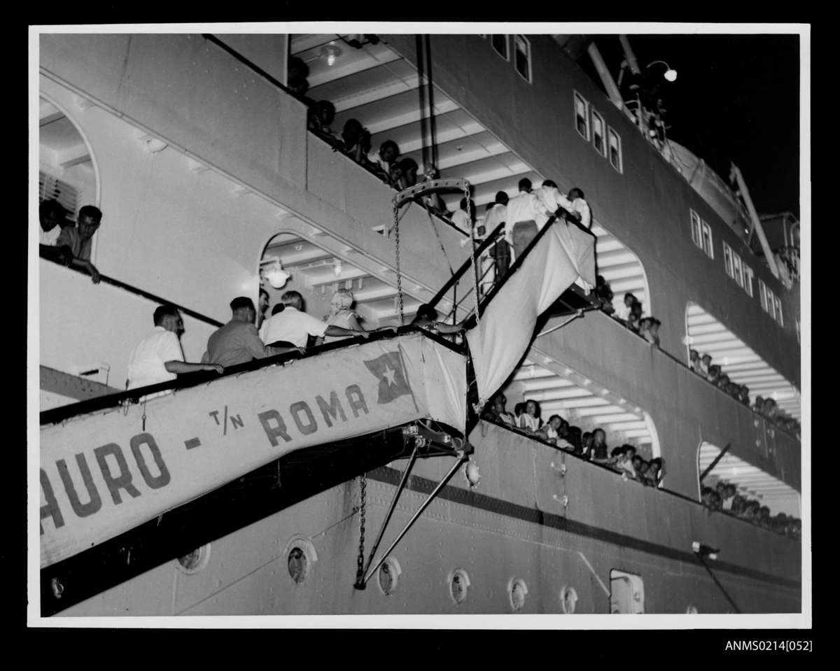 Skaubryn survivors climb the gangway of the Flotta Lauro liner Roma, 1958. ANMM Collection Gift from Barbara Alysen ANMS0214[052]. Reproduced courtesy International Organisation for Migration.