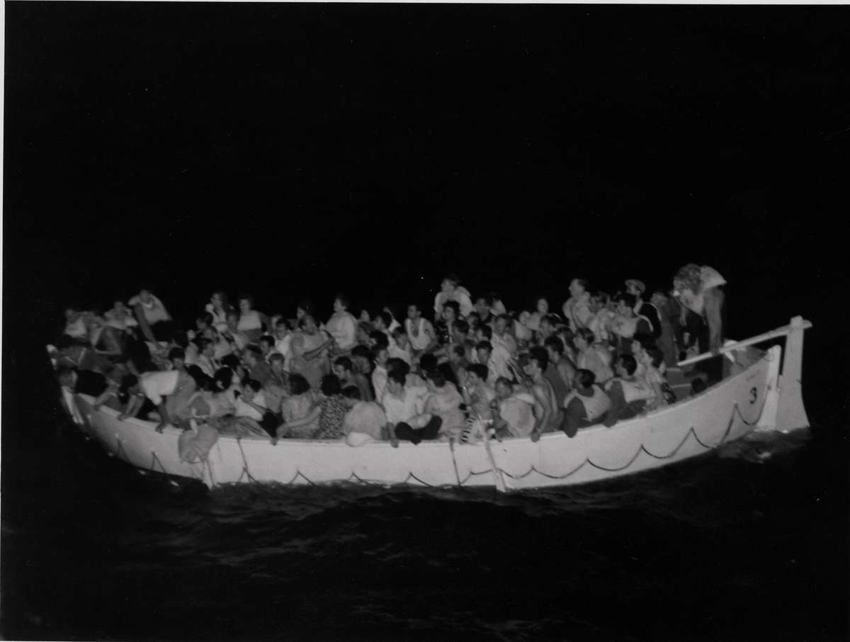 A lifeboat from Skaubryn in the Indian Ocean at night, 1958. ANMM Collection Gift from Barbara Alysen ANMS0214[010]. Reproduced courtesy International Organisation for Migration.