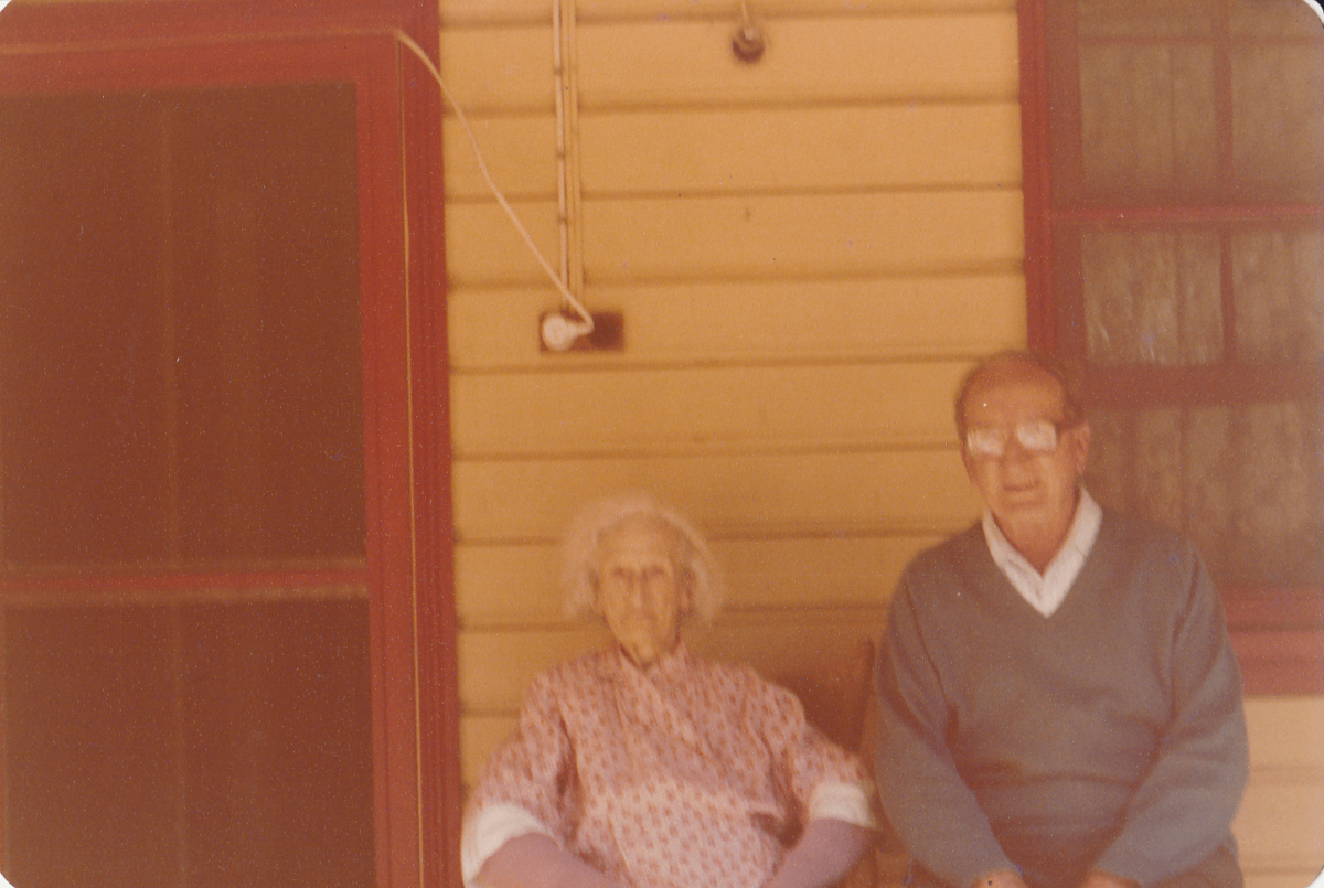 John Watt Jr and his mother Francis at the old Ilulka post office. Image courtesy of the Iluka Historical Society.