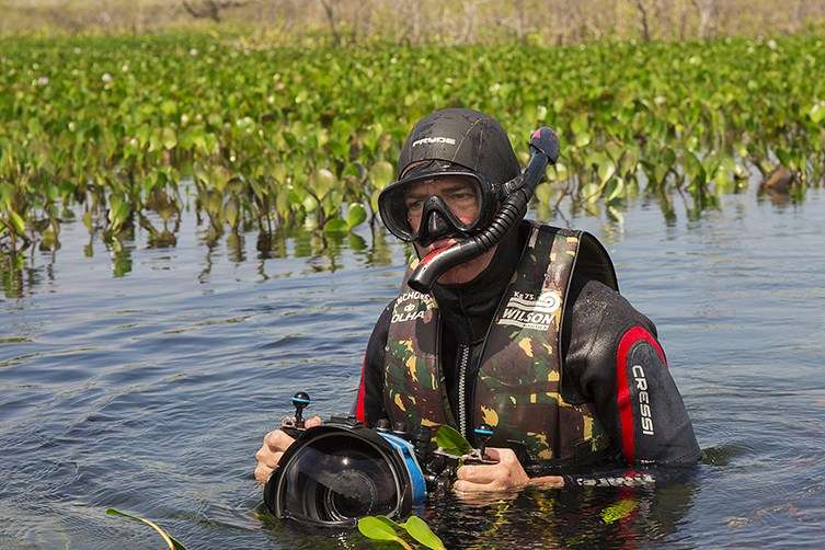Michel Roggo in the field with his snorkel and camera equipment in the Pantanal, the world's largest tropical wetland. © André Riedo.