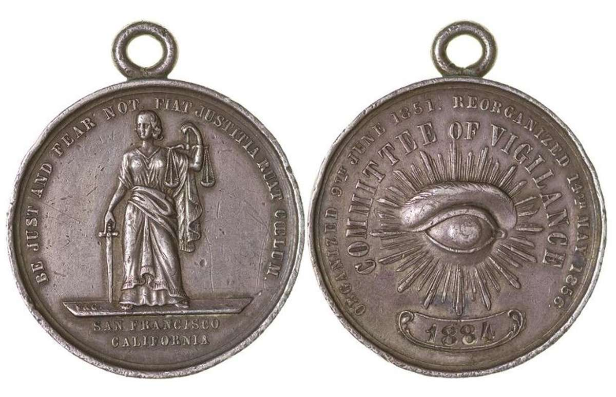 "Very rare 1856 San Francisco Committee of Vigilance Medal. The all-seeing eye, usually  associated with Masonic symbolism is arguably used here to suggest surveillance as a means of social discipline. Lady Justice is not blindfolded, but her sword remains beneath the balanced scales, indicative that punishment is placed second to that of the law. 1884 is the issue number. Image: <a href=""www.lofty.com/products/very-rare-1856-san-francisco-committee-of-vigilance-silver-medal-1-62uhe"">LOFTY</a>."