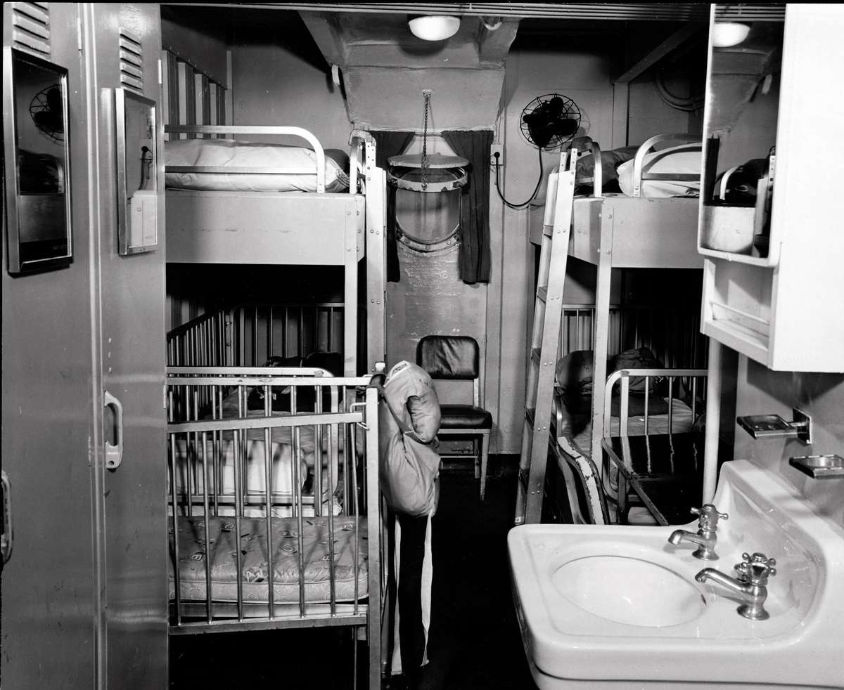 Family cabin, including cot, on an ICEM vessel to Australia 1946-1958. Despite the luxury of a sink and window, it is hard to think that the bunk ladders would amuse toddlers or children for long. ANMM Collection ANMS0214[092].