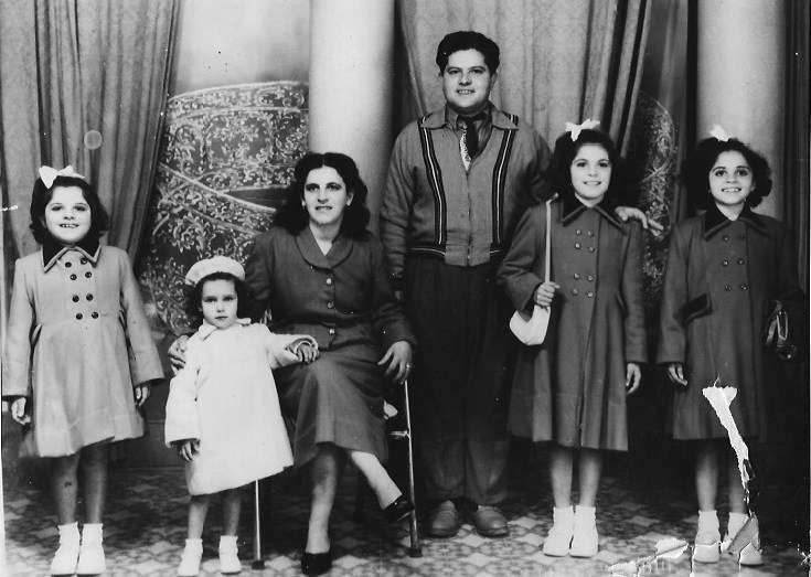 The Camenzuli family in Paola, Malta, a few days before their departure for Australia on <em>Skaubryn</em>, 1958. From left: Lucy, Lina, Georgina, Zaren, Mary and Joyce. Reproduced courtesy Camenzuli family.