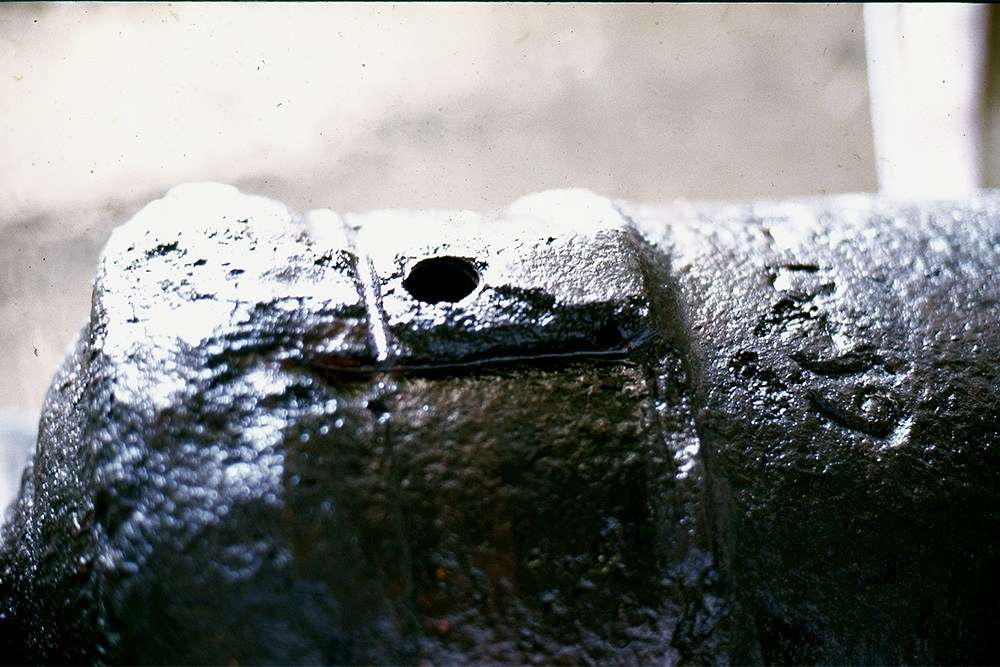 Vent patch showing holes for attaching the flint-lock firing mechanism. Image: Nigel Erskine.
