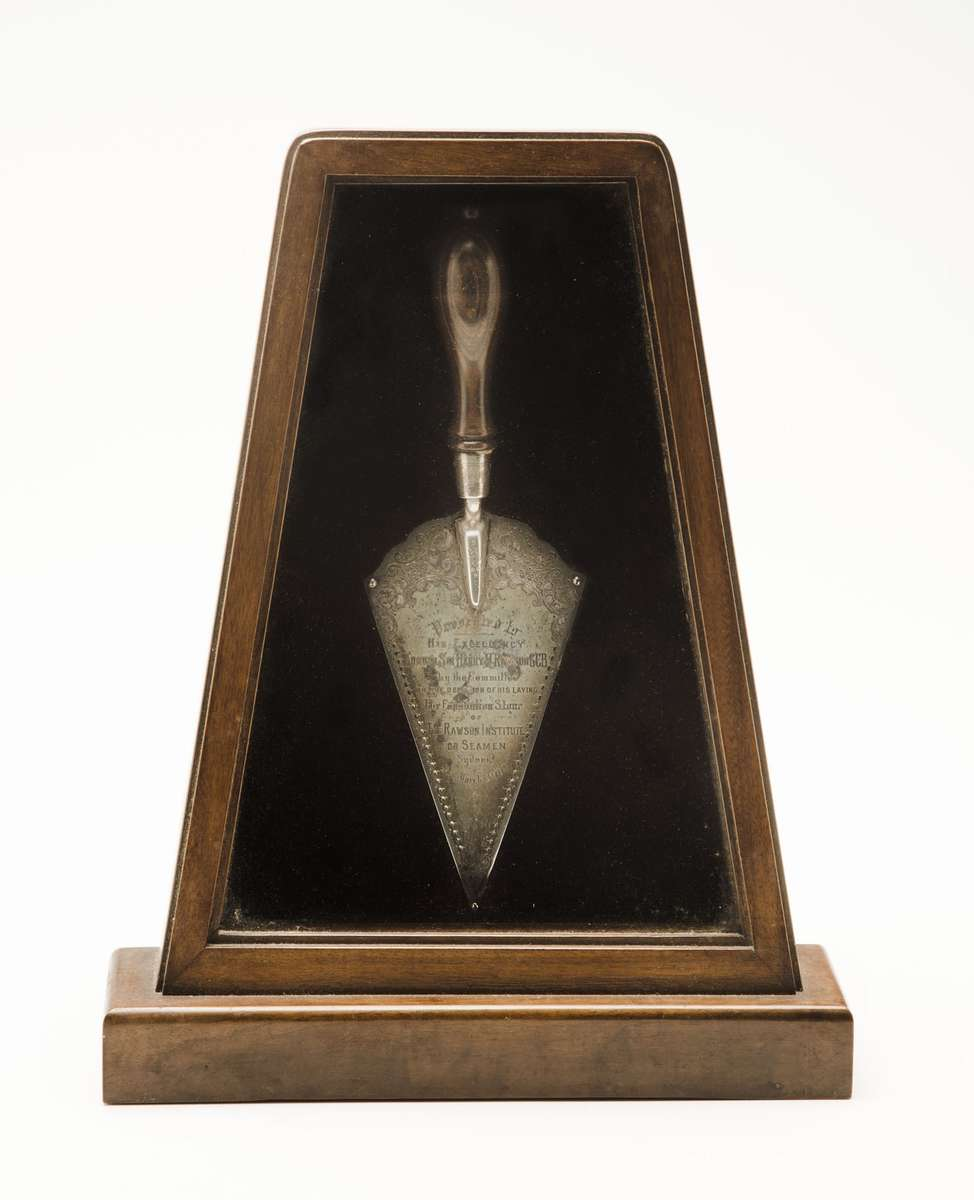 Silver presentation trowel, presented to Admiral Sir Harry Rawson GCB for use in laying the foundation stone of the Rawson Institute for Seamen, 18 March 1909. ANMM Collection 00054907 Gift from Mission to Seafarers. Image: Emma Bjorndahl/ANMM.