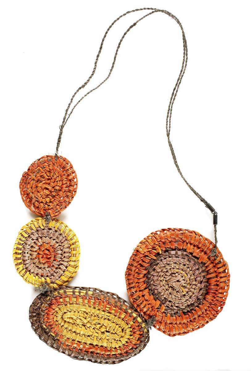 Necklace woven from pandanus and bush string with natural dyes, made by Mavis Warrngilna Ganambarr for Australian Indigenous Fashion Week (AIFW) 2014. ANMM Collection 00054381.