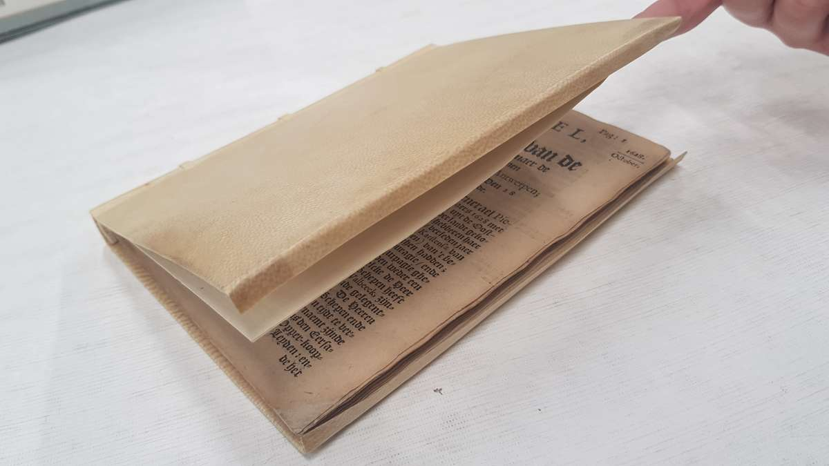 A vellum covered book from the 17th century. ANMM Collection 00006056.
