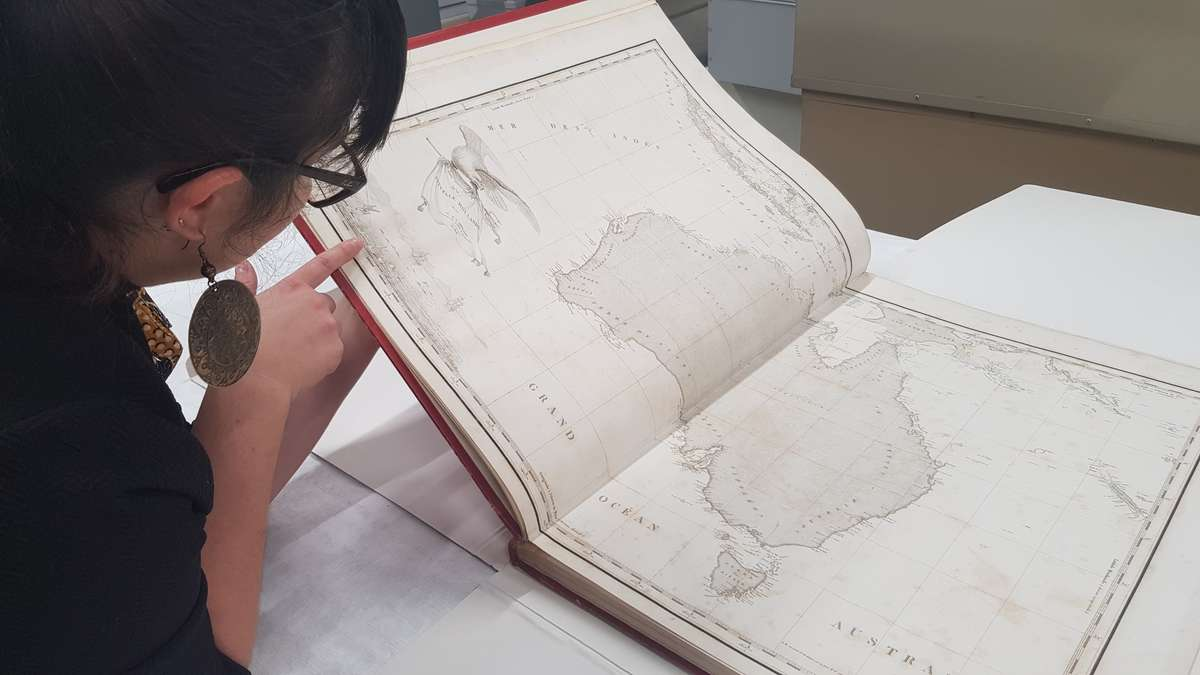 An atlas featuring early maps of Australia is an example of larger books in the collection. ANMM Collection 00050333.
