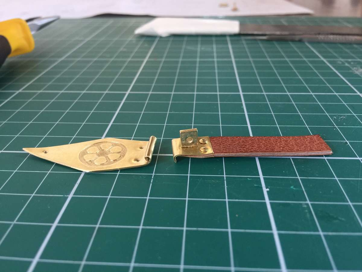 Creating a metal clasp from brass and leather by hand. Image: Lucilla Ronai.