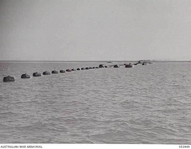 The anti-submarine boom net used to protect Darwin Harbour during World War II. It was the longest such net used during the war. Image: Australian War Memorial.