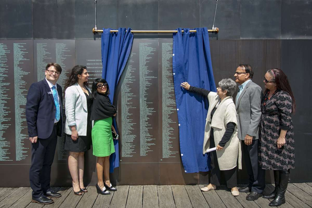 The unveiling of panels 80 and 81 on the Welcome Wall. From left: Kevin Sumption PSM, Director and CEO of ANMM, Melissa Oujani, Sonia Gandhi, Eva Rossen (Szwarcberg), Dr Ish Sharma and Donna Ingram. Image: Andrew Frolows/ANMM.