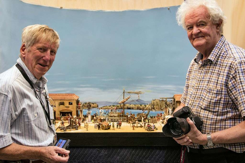 Roger Scott and Geoff Barnes photographing their model of the Roman port of Misenum in the Museum storerooms before it went on display as part of Pompeii: The untold Roman rescue. Image: Andrew Frolows/ANMM.