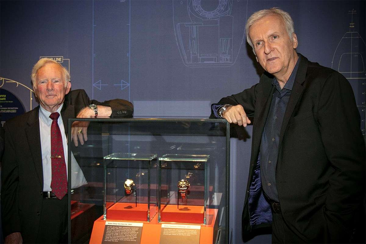 Don Walsh and James Cameron with their experimental Rolex watches which are a testament to the engineering challenges faced by humanity to reach the deepest part of the ocean. Image: Andrew Frolows/ANMM.