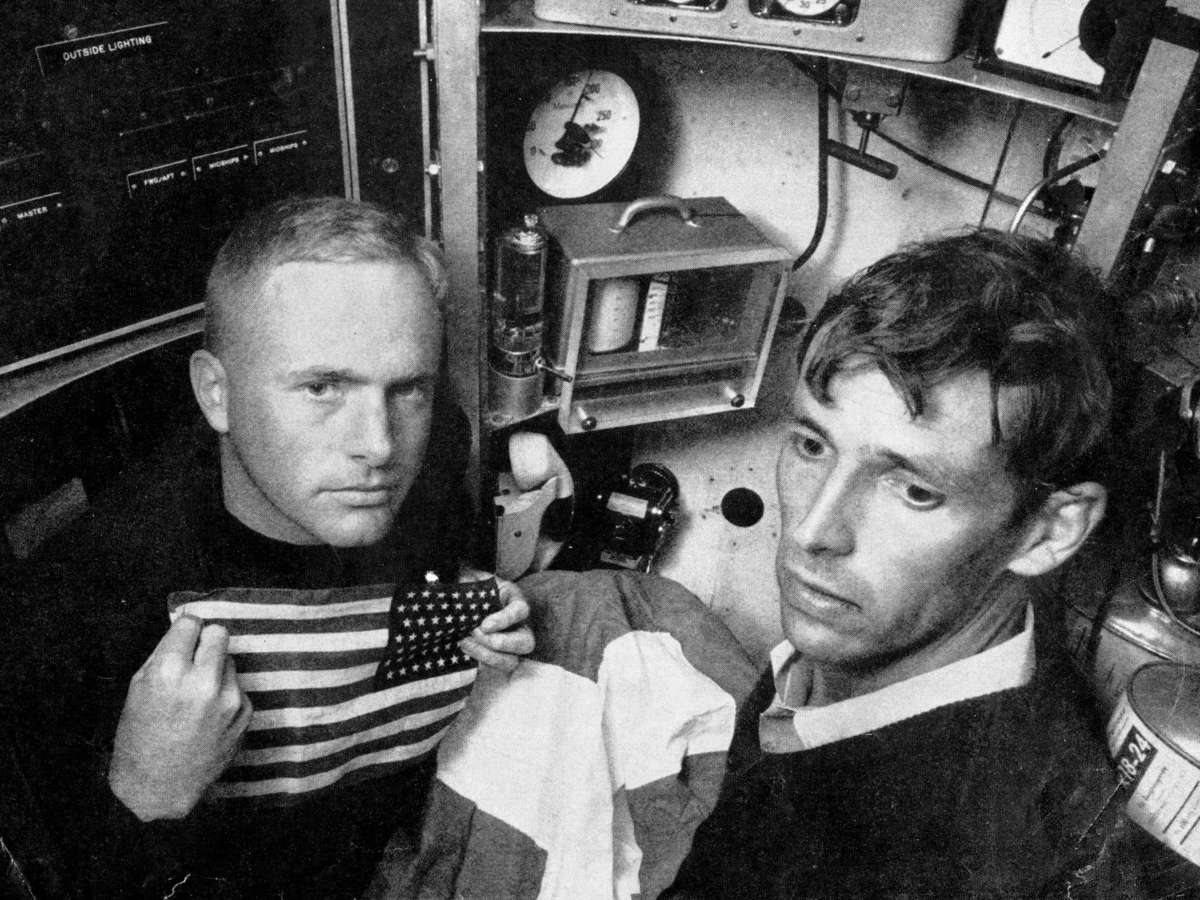 Lieutenant Don Walsh (left) and Jacques Piccard in the bathyscaphe. Image: Courtesy Don Walsh/NOAA Ship Collection.