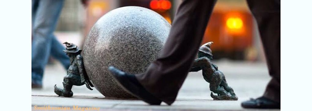 Tiny Statues in Cities around the World