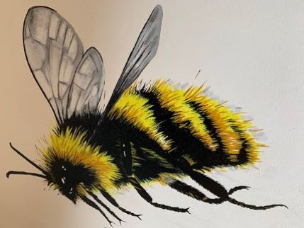 Bee painting local cafe