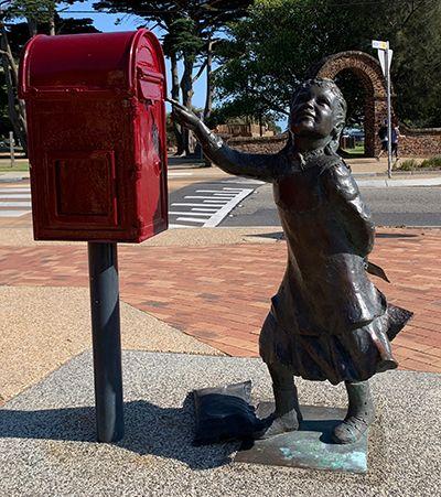 Statue of girl posting letter
