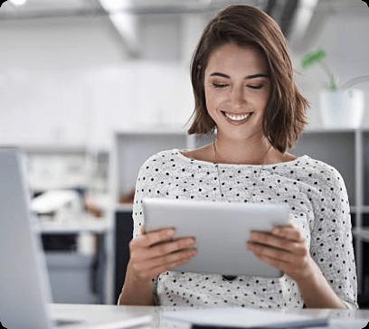 Happy girl looking website on her iPad