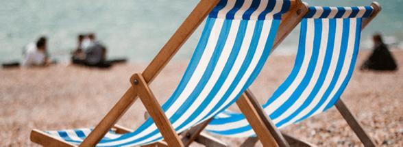 Blue and White Beach Chairs on Beach