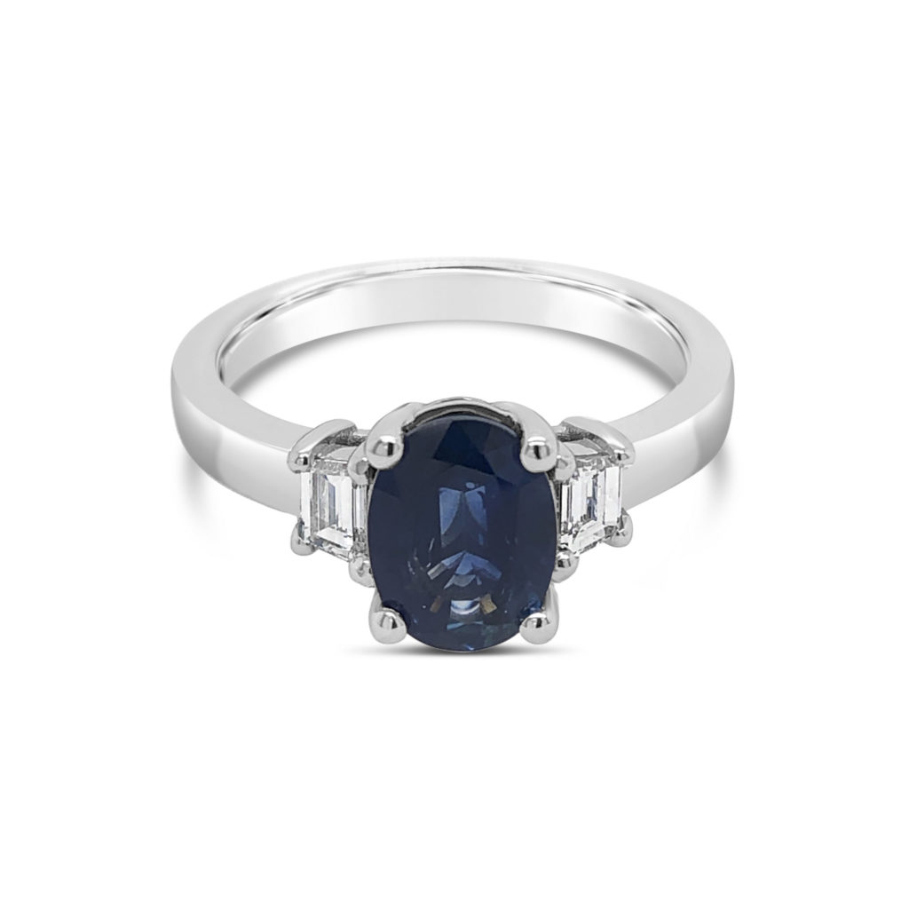 Three stone Sapphire and Diamonds Engagement ring