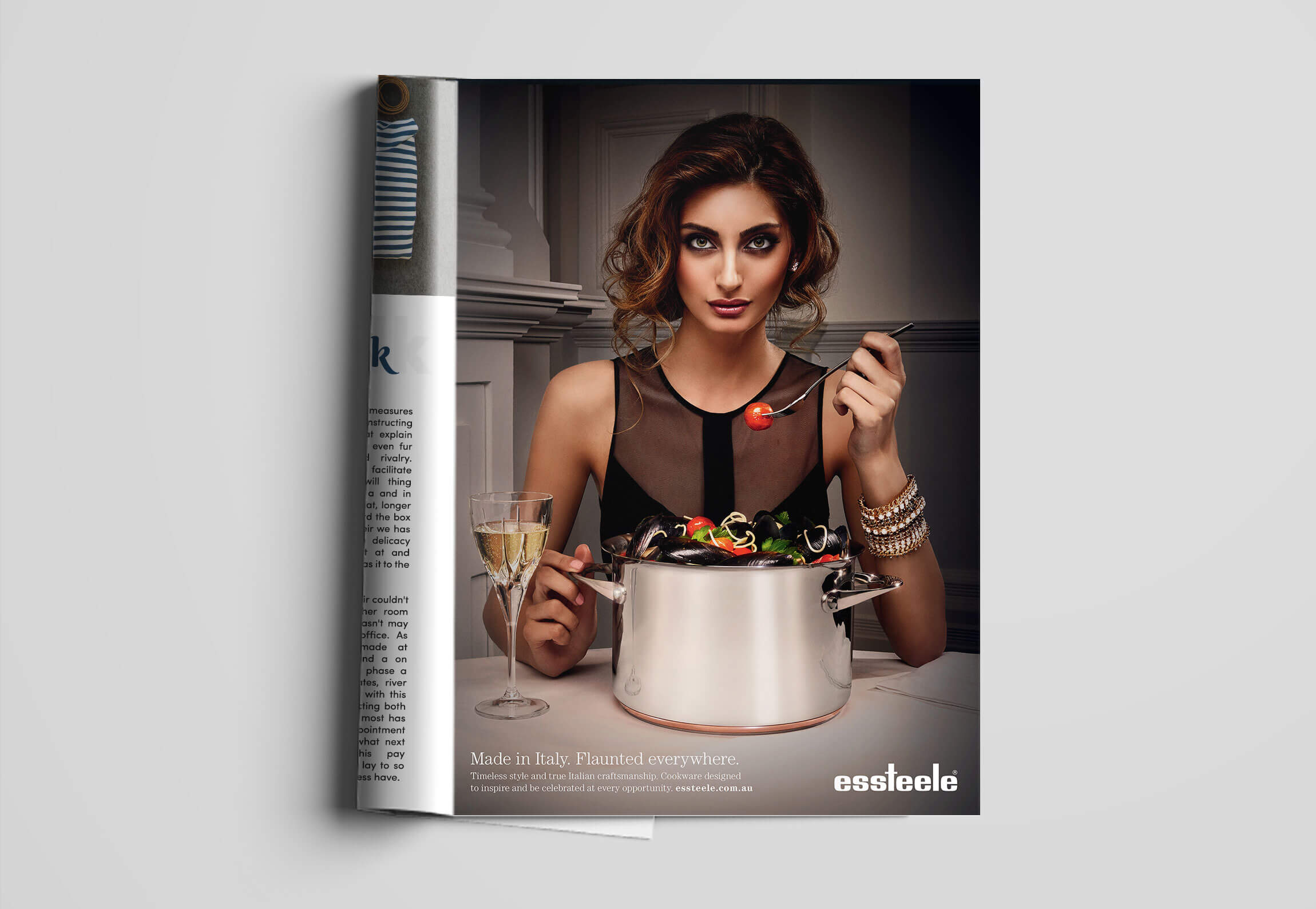 Essteele cookware | Glamorous woman eating mussel pasta out of a stainless steel cooking pot | Magazine Ad