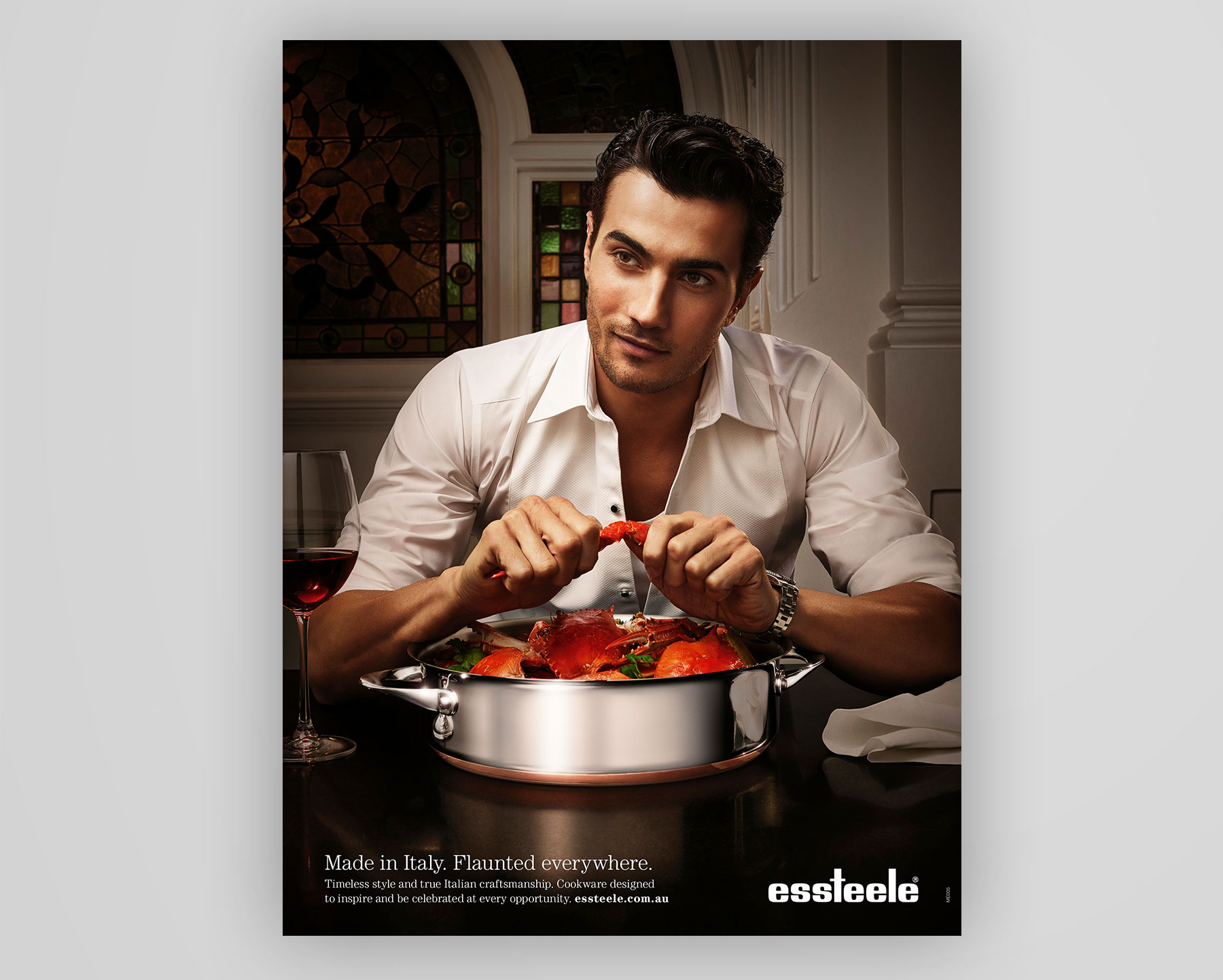 Essteele cookware | Handsome man eating crabs out of a stainless steel cooking pot | Magazine Ad