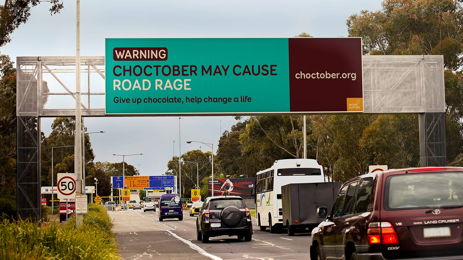Choctober Billboard Outdoor Media | Warning. Choctober may cause road rage. Give up chocolate, help change a life