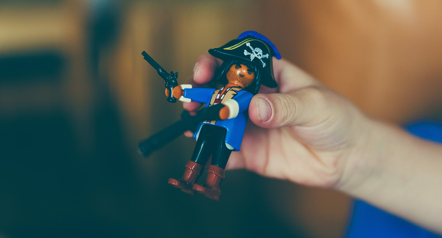Man holds pirate Lego character