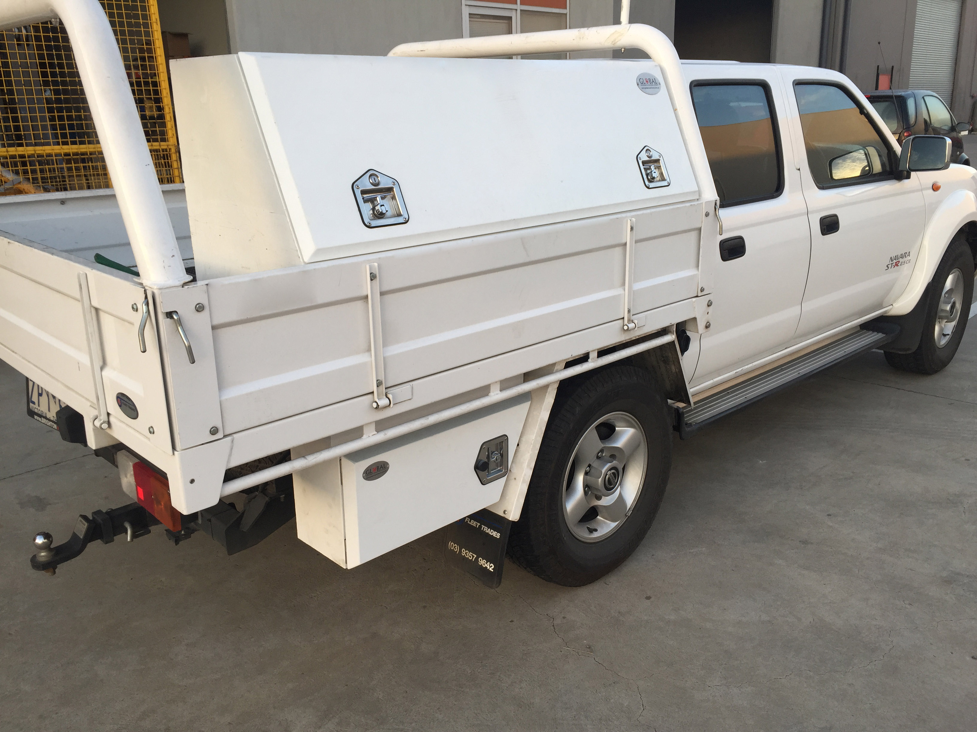 White left steel underbody Toolbox when installed in a truck with the lid closed.