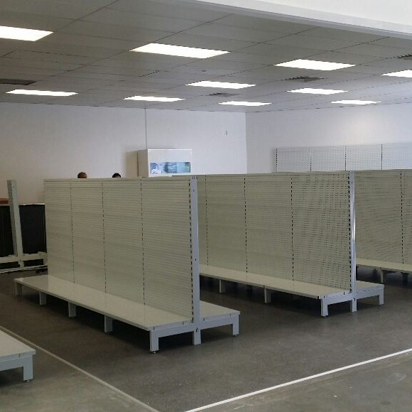 Example of Global Industrial Double Sided Gondola Shelf units in used on store.