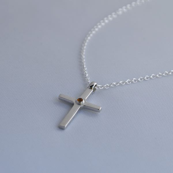 Must have clean cross Image3Description for everyday wear. This pendant is 2cm long, 2.5mm thick and weight slightly above 5.20 grams, something you wouldn't find for this price.</p>\nVery solidly made out of sterling silver and the shine will last long due to the rhodium plating over it.</p>\nThis is a perfect valentine day gift. Order this before you miss out!</span></p>\nShipping to Melbourne, Sydney, Perth, Brisbane, Adelaide, Gold Coast, Hobart, Darwin.\nImage4Description :  Citrine\nImage4