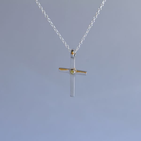 Must have clean cross Image3Description for everyday wear. This pendant is 2cm long, 2.5mm thick and weight slightly above 5.20 grams, something you wouldn't find for this price.</p>\nVery solidly made out of sterling silver and the shine will last long due to the rhodium plating over it.</p>\nThis is a perfect valentine day gift. Order this before you miss out!</span></p>\nShipping to Melbourne, Sydney, Perth, Brisbane, Adelaide, Gold Coast, Hobart, Darwin.\nImage4Description :  Peridot\nImage4