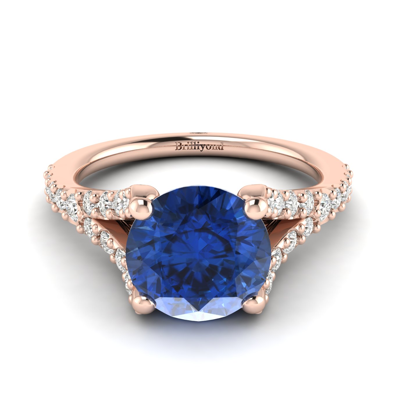 A 6mm blue Ceylon sapphire is handset over a solid 18k rose gold band with four prongs.