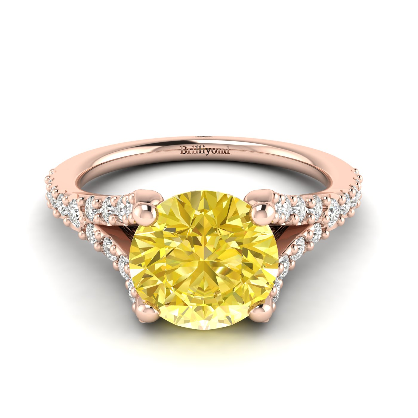 Yellow Ceylon sapphire engagement ring with pavé split shank set white created diamond accent stones.
