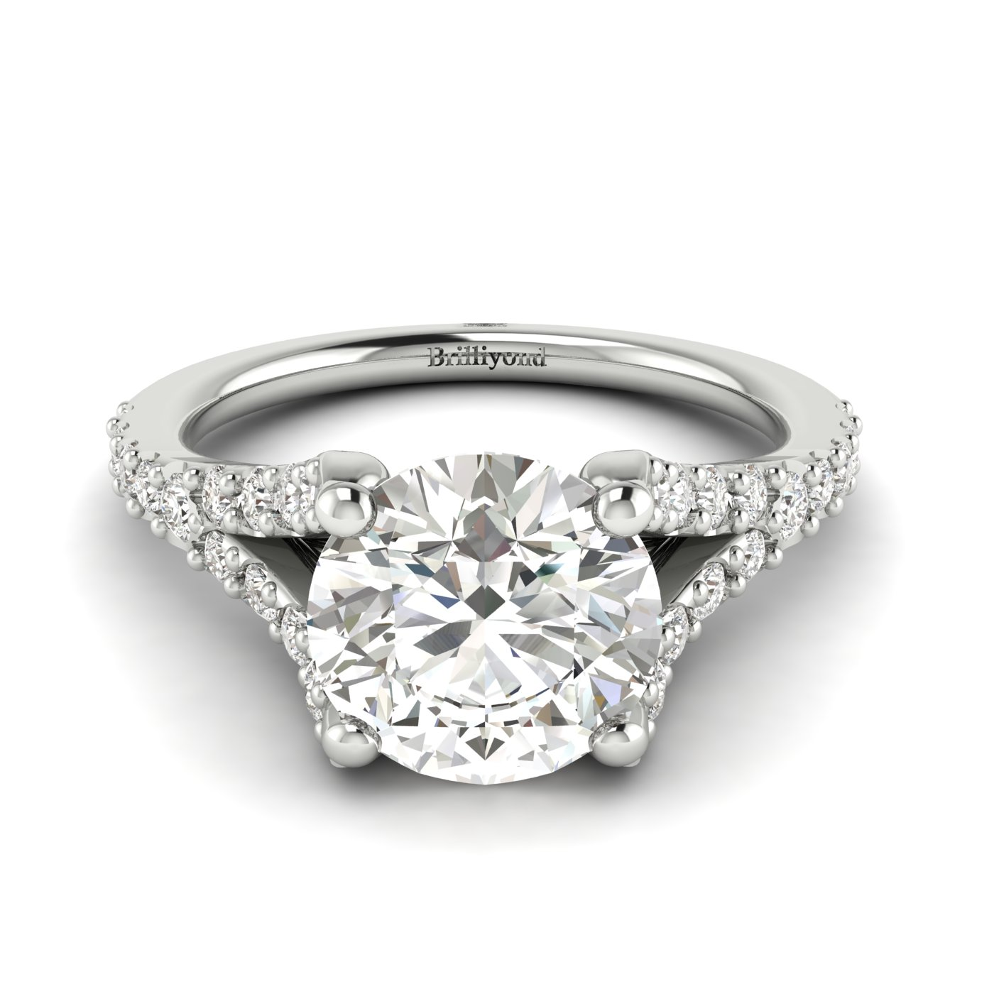 A four-pronged diamond engagement ring featuring 26 white cubic zirconia accent stones in pavé split shank setting.