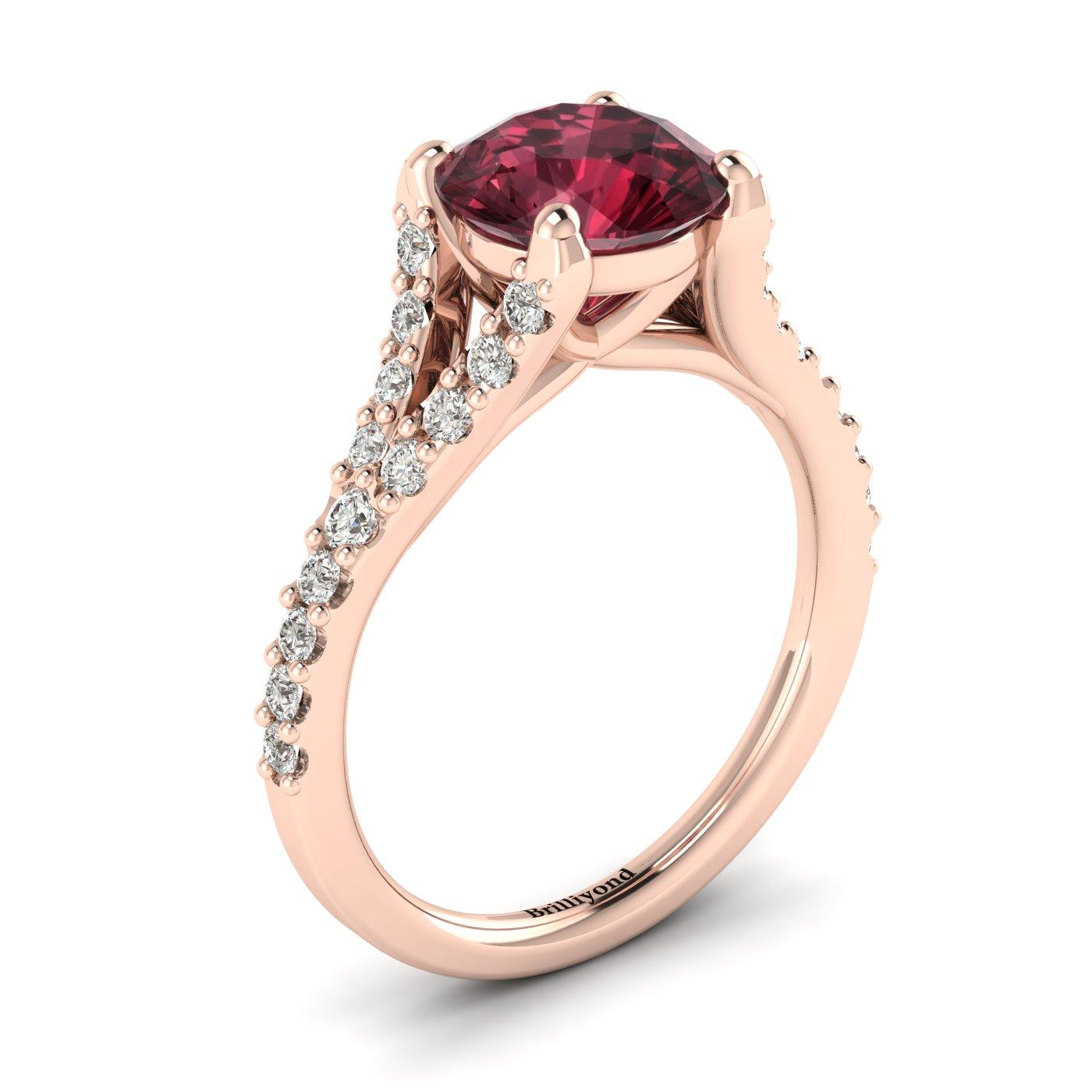 A natural 6mm round cut garnet handset over an 18k rose gold engagement ring.