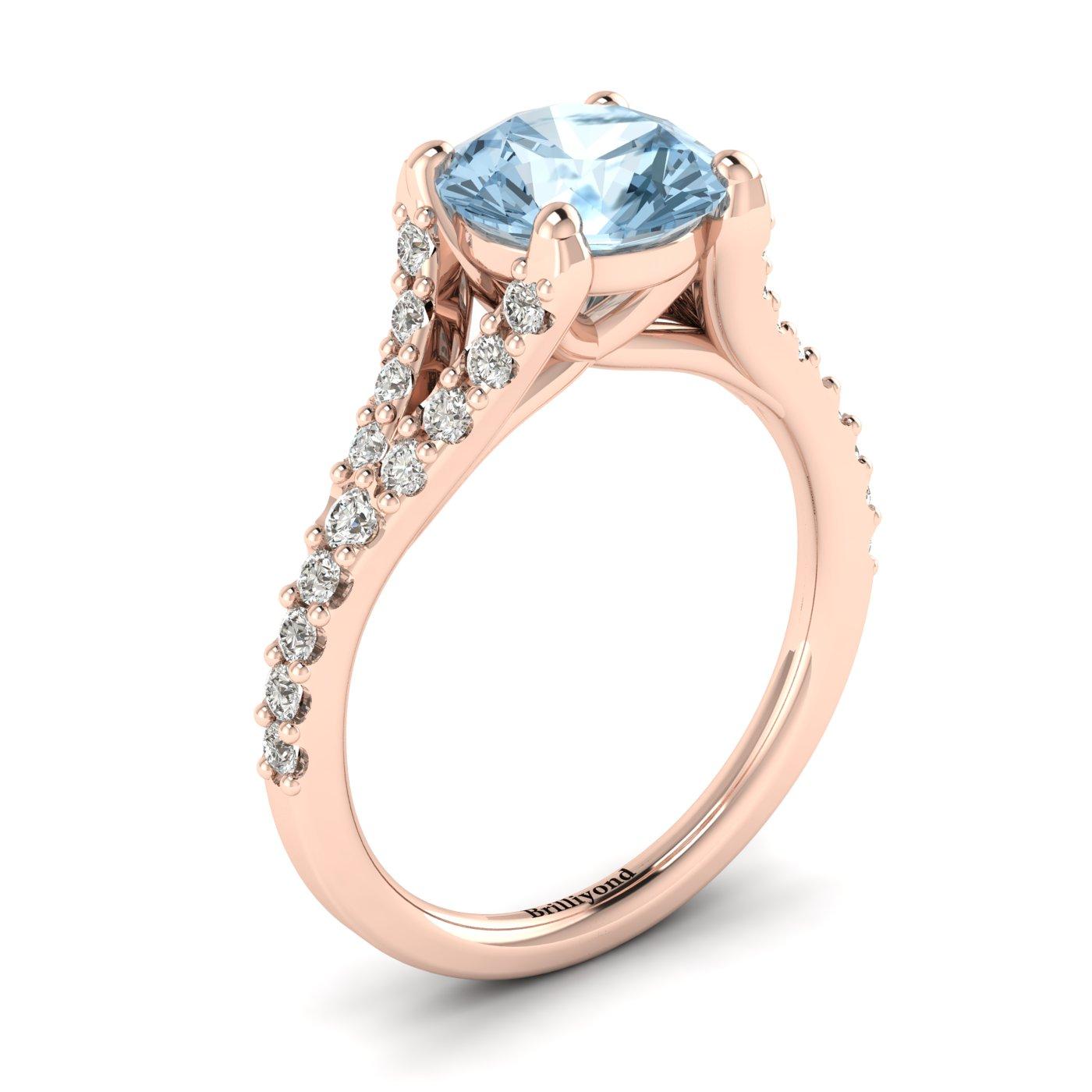 A unique rose gold engagement ring with pavé split shank set white cubic zirconia accent stones.