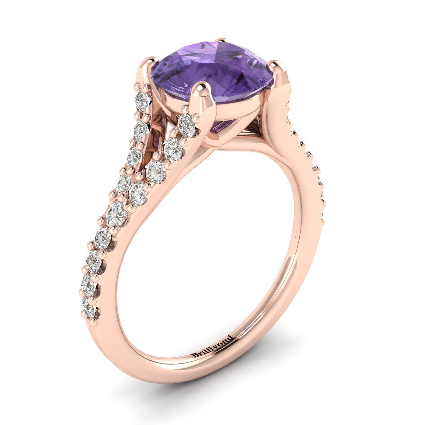 26 white created diamonds in a spectacular pavé split shank setting handset in 18k rose gold band.
