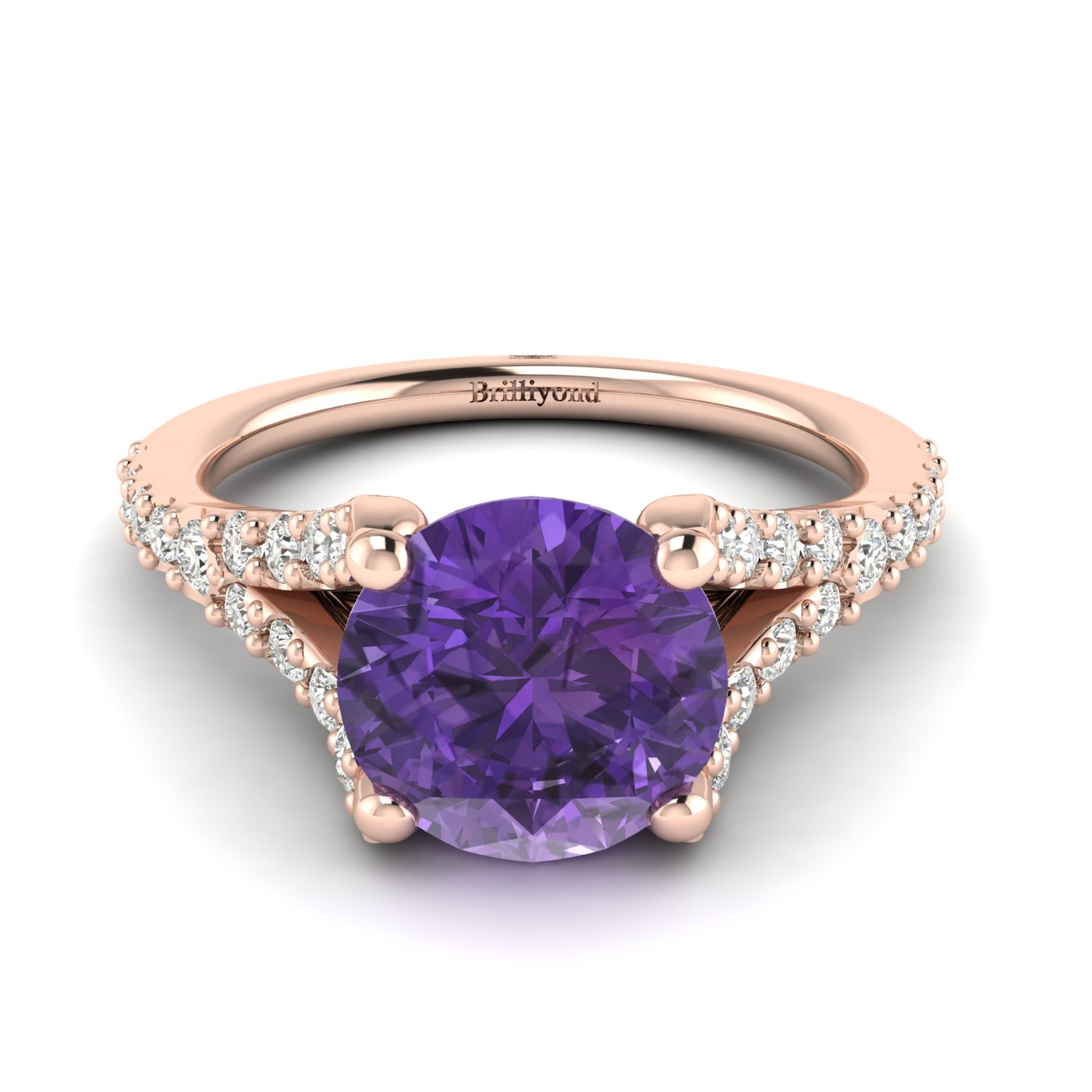 A four-pronged 6mm natural amethyst centre stone in a round cut setting.