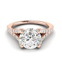 A Juliana inspired engagement ring with 26 white cubic zirconia in a pavé split shank setting.