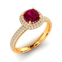 118 Genuine Diamonds embellished the yellow gold band of this ruby ring